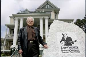 Bluegrass music legend Ralph Stanley poses outside his museum in Clintwood, Va., Wednesday, April 19, 2006. The 79-year-old patriarch of mountain music has always had a progressive streak. His stirring rendering of 'O Death' on the 'Oh Brother, Where Art Thou?' movie soundtrack introduced him to young audiences the world over, and his latest recording, a tribute to the Carter Family, taps a contemporary fascination with roots music. AP Photo / Steve Helber